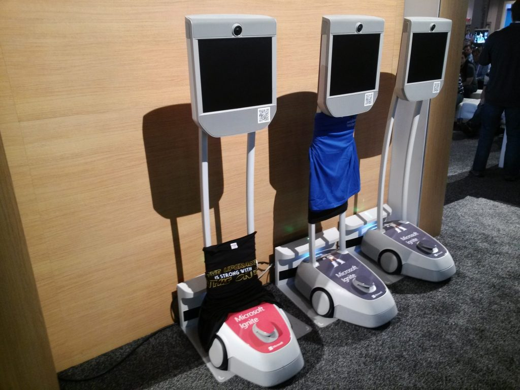 Video conferencing robots like these roamed the exhibit hall alongside the attendees.